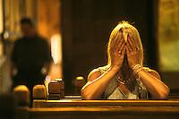 EEUU. Nuevo México. Chimayó<br /> Una mujer reza en el Santuario de Chimayó<br /> <br /> USA. New Mexico. Chimayo<br /> A woman prays at Chimayo Sanctuary<br /> <br /> © JOAN COSTA