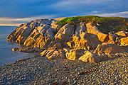 Rocky shoreline of Chedabucto Bay at sunset, Fox Island, Nova Scotia, Canada