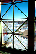 View of frozen Como Lake through an interesting window from the park pavilion.  St Paul Minnesota USA