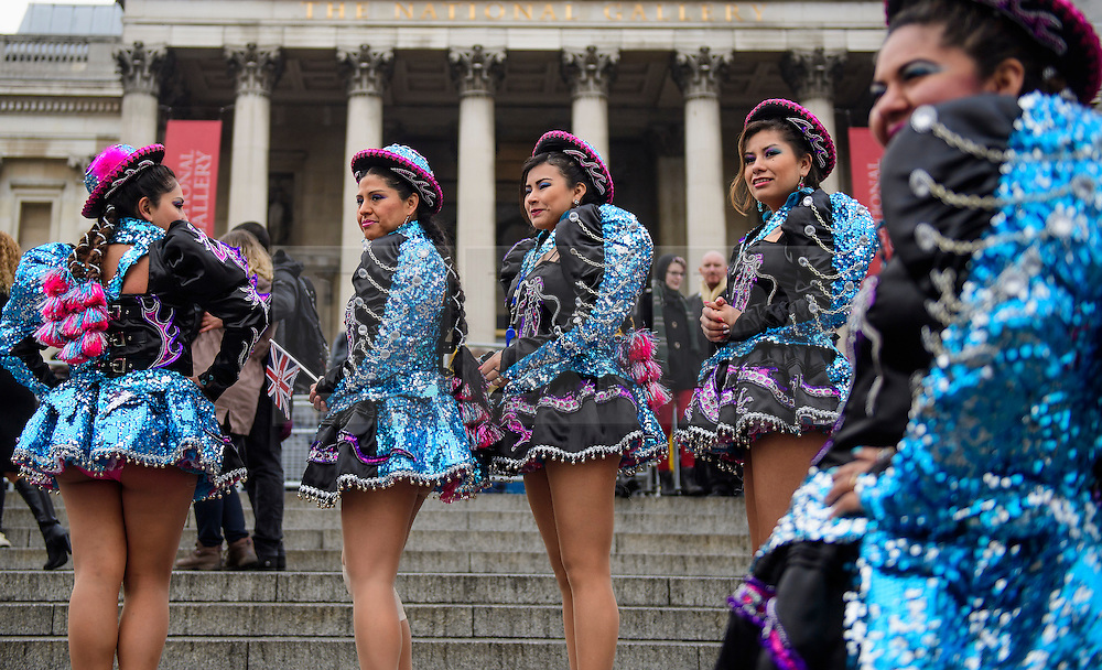 © Licensed to London News Pictures. 30/12/2016. London, UK. Bolivian dance group Caporales San Simon Londres pose for a photograph before taking part in a warmup event for New Years celebrations, at Trafalgar Square in London. Security will be increased across most UK New Year celebrations this year following the Berlin Christmas market terrorism attack.  Photo credit: Ben Cawthra/LNP