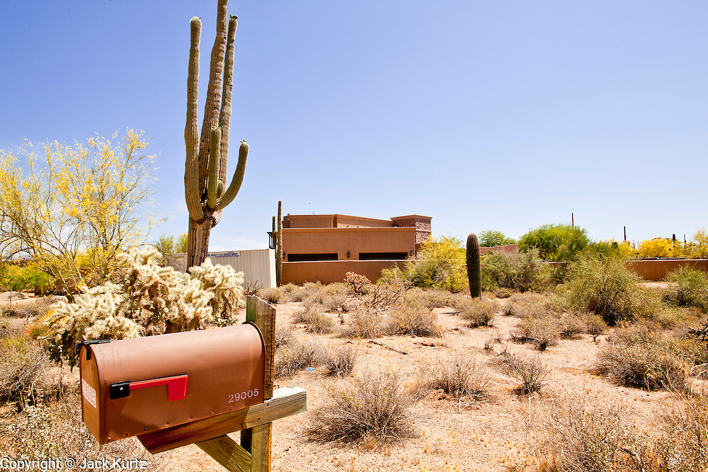 """22 MAY 2011 - SCOTTSDALE, AZ:  The mailbox of a home reportedly owned by Sarah Palin in Scottsdale, AZ. According to the Arizona Republic, Sarah Palin and her husband Todd Palin, bought the 8,000 square foot home for $1.695 million cash. The newspaper said the Palin's name does not appear on the paperwork and the home was bought by Safari Investments LLC out of Delaware. The paper said the deal """"appears designed to cloak the identity of a high-profile buyer."""" The home has six bedrooms, five bathrooms, a six car garage, swimming pool, spa, home theater, wine cellar and children's """"jungle gym"""" in the backyard. The home is surrounded by a tall wall with an electronic gate. Phoenix TV stations have reported that a black SUV with Alaska license plates has been seen entering and leaving the compound. People in the house have refused to comment on who owns the home. Neither Palin nor her husband have been seen at the home since news of the sale broke Saturday, May 21.   Photo by Jack Kurtz"""