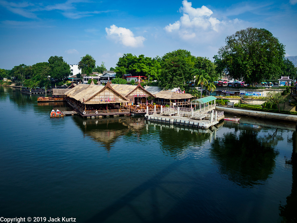 """09 JANUARY 2019 - KANCHANABURI, THAILAND: Looking north up the River Kwai from the famous """"Bridge On the River Kwai"""" in Kanchanaburi. Hundreds of thousands of Asian slave laborers and Allied prisoners of war died in World War II constructing the """"Death Railway"""" between Bangkok and Rangoon (now Yangon), Burma (now Myanmar) for the Japanese during World War II.  The bridge is now one of the most famous tourist attractions in Thailand.      PHOTO BY JACK KURTZ"""