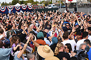 Crowd of Supporters High Five Each Other at a Bernie Sanders Rally in Santa Ana California