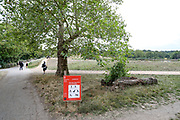A sign suggests that people should keep 2 meters distance, forbids people to swim in the ponds and bbq-ing, as well as large gatherings in Hampstead Heath Park as the British people gathered to enjoy the hot weather in northwest London on Friday, Aug 7, 2020. <br /> Exceptionally hot weather is set to continue in parts of the UK throughout the weekend, the Met Office said. The highest temperatures are expected in England and Wales, with a fresher weather forecast for Scotland and NI. The UK has seen its hottest day in August for 17 years, as temperatures reached more than 36C (96.8F) in south-east England, British press reports. (VXP Photo/ Vudi Xhymshiti)