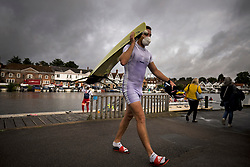 © Licensed to London News Pictures. 09/08/2021. Henley-on-Thames, UK. Rowers leave the water after training in the rain, underneath grey skies, ahead of the the Henley Royal Regatta which starts on Wednesday, set on the River Thames by the town of Henley-on-Thames in Oxfordshire, England. Established in 1839, the five day international rowing event, raced over a course of 2,112 meters (1 mile 550 yards), is considered an important part of the English social season. Photo credit: Ben Cawthra/LNP