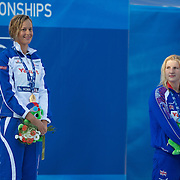 After seeing Federica Pellegrini of Italy break the World Record to win gold in the Women's 400m Freestyle, Rebecca Adlington, who won bronze, looks on at the podium presentation ceremony Joanne Jackson of Great Britain finished second at the World Swimming Championships in Rome on Sunday, July 7, 2009. Photo Tim Clayton.
