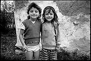 Roma - Romanian Gypsies - Roma kids with cigarette, Valcau, Transylvania, Romania. August 1996