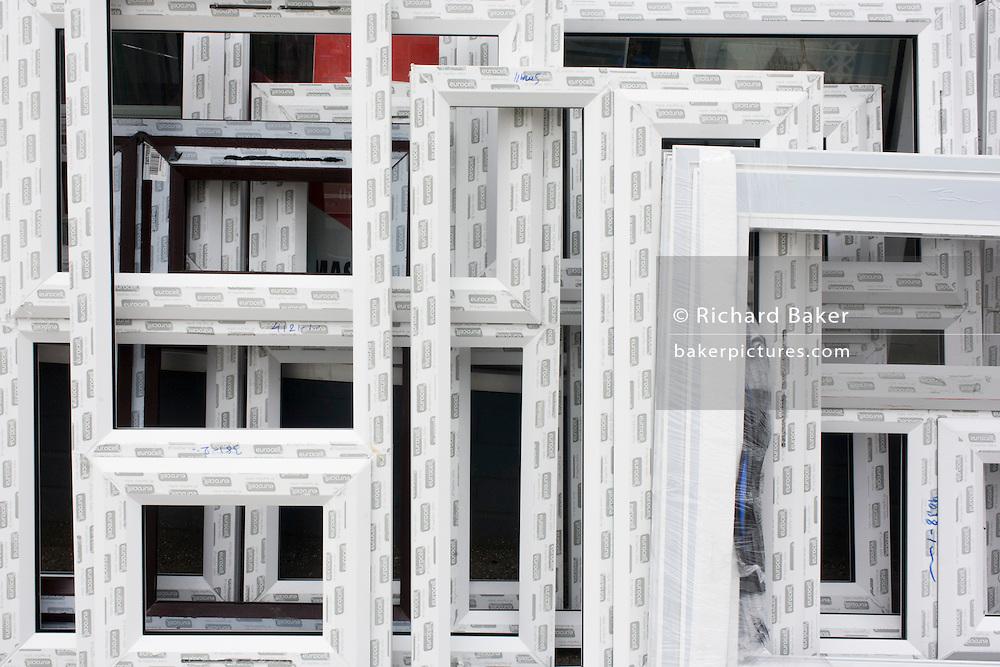 Detail of double-glazing window frames outside a glazier shop in a south London street.