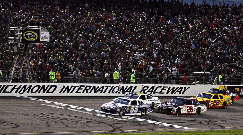 Apr 28, 2012; Richmond, VA, USA; NASCAR Sprint Cup driver Mark Martin (55) leads the start of the Capital City 400 at Richmond International Raceway. Mandatory Credit: Peter Casey-US PRESSWIRE.