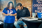 SHOT 12/10/17 1:16:42 PM - Former Buffalo Bills wide receiver and Hall of Fame player Andre Reed signs autographs and meets with fans at LoDo's Bar and Grill in Denver, Co. as the Buffalo Bills played the Indianapolis Colts that Sunday. Reed played wide receiver in the National Football League for 16 seasons, 15 with the Buffalo Bills and one with the Washington Redskins. (Photo by Marc Piscotty / © 2017)