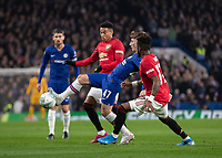 Football - 2019 / 2020 EFL Carabao (League) Cup - Fourth Round: Chelsea vs. Manchester United<br /> <br /> Billy Gilmour (Chelsea FC) sandwiched between Jesse Lingard (Manchester United) and Fred (Manchester United) reaches for the ball at Stamford Bridge <br /> <br /> COLORSPORT/DANIEL BEARHAM