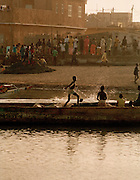 African Kids playing by the sea - Saint-Louis Senegal