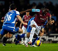 Photo: Alan Crowhurst.<br />West Ham United v Wigan Athletic. The Barclays Premiership. 06/12/2006. Nigel Reo-Coker (R) attacks for West Ham.