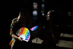 © Licensed to London News Pictures . 25/08/2019. Manchester, UK. In temperatures exceeding 30 degrees centigrade , fans of Ariana Grande and other musical acts gather at Mayfield Depot ahead of performances this evening . Manchester's annual Gay Pride festival , which is the largest of its type in Europe , celebrates LGBTQ+ life . Photo credit: Joel Goodman/LNP