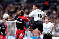 Photo: Leigh Quinnell.<br /> Luton Town v Southampton. Coca Cola Championship. 07/04/2007. Lutons Lewis Emanuel jumps above Southamptons  Jhon Viafara.