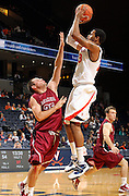 Nov 6, 2010; Charlottesville, VA, USA; Virginia Cavaliers f Mike Scott (23) shoots over Roanoke College g Matt Crizer (25) Saturday afternoon in exhibition action at John Paul Jones Arena. The Virginia men's basketball team recorded an 82-50 victory over Roanoke College.