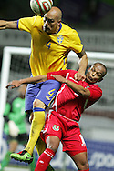 Robert Earnshaw of Wales is challenged by Daniel Majstorovic of Sweden.International friendly, Wales v Sweden at the Liberty Stadium in Swansea on Wed 3rd March 2010. pic  by  Andrew Orchard