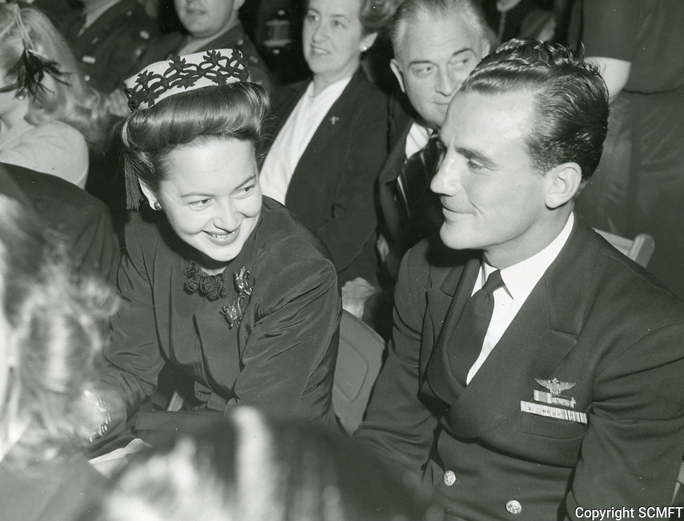 11/4/43 Olivia De Havilland sits with Lt. Howard Burnett at the Hollywood Canteen