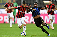 Suso of AC Milan and Kwadwo Asamoah of Internazionale compete for the ball during the Serie A 2018/2019 football match between Fc Internazionale and AC Milan at Giuseppe Meazza stadium Allianz Stadium, Milano, October, 21, 2018 <br />  Foto Andrea Staccioli / Insidefoto