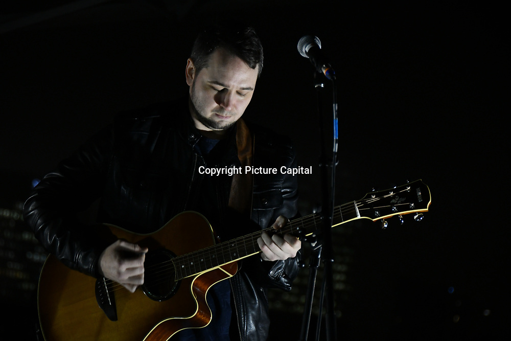 Chris Boom preforms Sleep Out fundraiser to help homeless young people at Greenwich Peninsula Quay on 15 November 2018, London, UK.