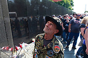 Vietnam Veteran Jerry Hogan, who served in B Troop, 1st Squadron, 9th Cavalry, 1st Cavalry Division from 1969-1971, looks for the name of his buddy John Gruber, during his first visit to the Vietnam Wall Memorial. Gruber was killed in a helicopter crash in June 1971.