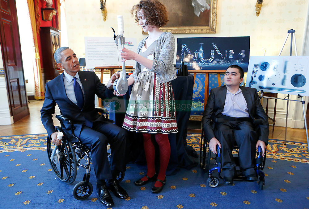 Us President Barack Obama tries an attachable lever that can make wheelchair movements easier and less tiring that was created by Kaitlin Rees (C) from Dover Massachusetts, while Mohammed Sayed (R) from Cambridge Massachusetts who developed a 3D-printed modular arm looks up, at the White House, in Washington, DC, USA, on March 23, 2015. The 2015 White House Science Fair is a celebration of students winners of STEM (Science, technology, engineering and math) competitions from across the country. Photo by Aude Guerrucci/Pool/ABACAPRESS.COM  | 492967_003 New York City Etats-Unis United States