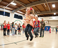 Harper Meehan and Sophia Lehr get in sync with the double jumprope during Gilford Elementary School's Jump for Heart event Wednesday morning.  (Karen Bobotas/for the Laconia Daily Sun)