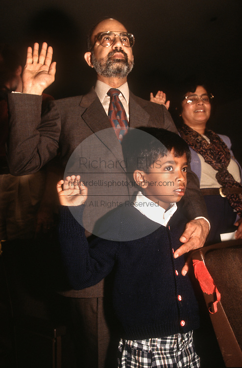 A south asian family is takes the oath of citizenship during an immigration naturalization ceremony November 12, 1996 in Washington, DC.