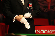a referee puts his gloves on. Welsh open snooker 2010 at the Newport Centre, Newport, South Wales, day 1 on Mon 25th Jan 2010.   pic by  Andrew Orchard  , Andrew Orchard sports photography,