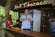 Cuba, Guantanamo, Local barman in a bar