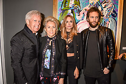 Left to right, James Nicholls, Danielle Nicholls,Kimberley Garner and Marc Jacques Burton at a private view of work by Bradley Theodore entitled 'The Second Coming' at the Maddox Gallery, 9 Maddox Street, London England. 19 April 2017.