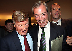 """© Licenced to London News Pictures. 26/05/2014. London. UK.  <br /> Nigel Farage, leader of the UK Independence Party (UKIP), is pictured celebrating his European Parliamentary success alongside party donor Paul Sykes at a press conference in London, May 26th 2014. The UKIP leader said his """"dream has become a reality"""" and UKIP is now the """"third force"""" in British politics after it topped the European polls.<br /> Photo Credit: Susannah Ireland"""