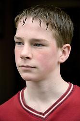 Teenage boy looking serious,