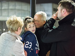 © Licensed to London News Pictures. 23/05/2017. Manchester, UK. A girl is brought to a police cordon from the Arena where she is greeted by relatives . Anxious parents wait by the police cordon for news of children inside the Manchester Arena . Police and other emergency services are seen near the Manchester Arena after reports of an explosion. Police have confirmed they are responding to an incident during an Ariana Grande concert at the venue. Photo credit: Joel Goodman/LNP