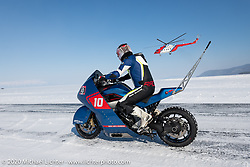 Evgeniy Pyatigorskiy racing a BMW K1600GT against a giant Russian Mi8 helicopter (manufactured just a few hours away in Ulan-Ude) at the Baikal Mile Ice Speed Festival. Maksimiha, Siberia, Russia. Friday, February 28, 2020. Photography ©2020 Michael Lichter.