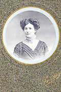 round portrait of adult woman 1900s set in a golden passe-partout