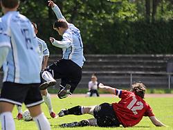 FODBOLD: Kienn Jensen (Helsingør) tackles af anfører Ludwig Siegismund (AB Tårnby) under kampen i Danmarksserien, pulje 1, mellem AB Tårnby og Elite 3000 Helsingør den 12. juni 2010 på Tårnby Stadion. Foto: Claus Birch