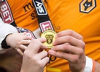 Football - 2017 / 2018 Sky Bet Championship - Wolverhampton Wanderers vs. Sheffield Wednesday<br /> <br /> Wolverhampton Wanderer's players with Championship medal at Molineux.<br /> <br /> COLORSPORT