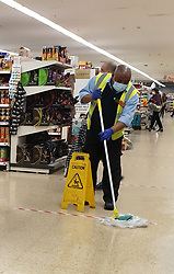 © Licensed to London News Pictures. 15/04/2020. London, UK. A Sainsbury's worker cleans the floor during coronavirus lockdown. The lockdown in its fourth week is to slow the spread of COVID-19 and reduce pressure on the NHS. Photo credit: Dinendra Haria/LNP
