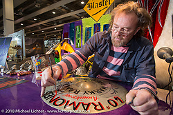 Blaster paints a 40th anniversary Ramones cymbal at the Motor Bike Expo. Verona, Italy. January 22, 2016.  Photography ©2016 Michael Lichter.