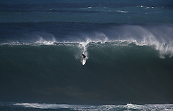 December 13, 2017 - Waimea Bay, Hawaii - A surfer drops in on a large wave at Waimea Bay. The big wave surfing spot only breaks in the winter when storms send large north swells toward the North Shore of Oahu. (Credit Image: © Erich Schlegel via ZUMA Wire)