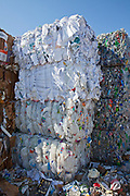 Stacks of paper and High-density polyethylene (HDPE) bottles, recycliing symbol #2. Recycling Center, Los Angeles, California, USA