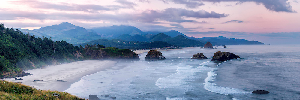 Panoramic view of Cannon Beach along the Oregon coast at sunrise from Ecola State Park.