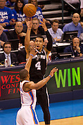 June 2, 2012; Oklahoma City, OK, USA; Oklahoma City Thunders guard Russell Westbrook (0) attempts to block a shot taken by San Antonio Spurs guard Danny Green (4) during the first half of a playoff game at Chesapeake Energy Arena.  Mandatory Credit: Beth Hall-US PRESSWIRE