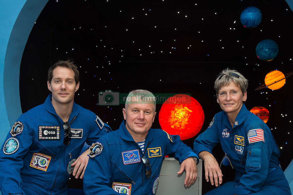 October 27, 2016 - File - Iowa native PEGGY WHITSON keeps piling up firsts in her long career as an astronaut. In two weeks, she will rocket into space again on her third mission to the International Space Station. She was its first female commander in 2007 and will become the first woman to ever command the space station twice. Combined with her 2002 mission, has logged the most days in space of any female in NASA history, 377. Pictured: June 26, 2016 - Baikonur, Kazakhstan - International Space Station crew Expedition 49 backup crew members pose in front of a mural of the planets during a tour of a museum June 26, 2016 in Baikonur, Kazakhstan. Members from L-R:   ESA astronaut Thomas Pesquet, Russian cosmonaut Oleg Novitskiy and American astronaut Peggy Whitson.  (Credit Image: © Andrei Shelepin/NASA/ZUMAPRESS.com)
