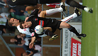 Photo: Ian Hebden.<br />Milton Keynes Dons v Hartlepool United. Coca Cola League 2. 09/09/2006.<br />Hartlepools Willie Boland (R) wins the ball from MK Dons Aaron Wilbraham (L).