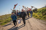 A group of people walks towards the prison with basque flags and banners asking the repatriation of basque prisoners. Caceres (Spain). February 20, 2016. Some friends and relatives of Basque political prisoners take part on a march to Caceres penitentiary center, within the campaign of 40 marches to 40 prisons where Basque prisoners are imprisoned. These marches are to denounce the dispersal policy those prisoners suffer since more than 25 years. (Gari Garaialde / Bostok Photo)