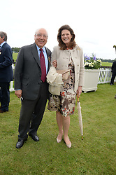 URS SCHWARZENBACH and his wife FRANCESCA at the 2013 Cartier Queens Cup Polo at Guards Polo Club, Berkshire on 16th June 2013.
