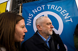 © Licensed to London News Pictures. 26/02/2016. London, UK. Leader of the labour party JEREMY CORBYN (centre)  attends a CND (Campaign for Nuclear Disarmament) rally in central London on February 27, 2016. Corbyn has been criticised for publicly supporting the CND campaign while Labour Party policy  backs the renewal of Trident nuclear programme. Photo credit: Ben Cawthra/LNP