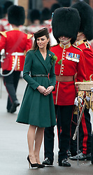 © London News Pictures. 17/03/2012. Aldershot, UK. The Duchess of Cambride CATHERINE (KATE) MIDDLETON presenting traditional sprigs of shamrock to the 1st Battalion Irish Guards at Mons Barracks in Aldershot, Hampshire, UK,  on Saint Patrick's Day, March 17th, 2012.  Photo credit : Ben Cawthra/LNP.